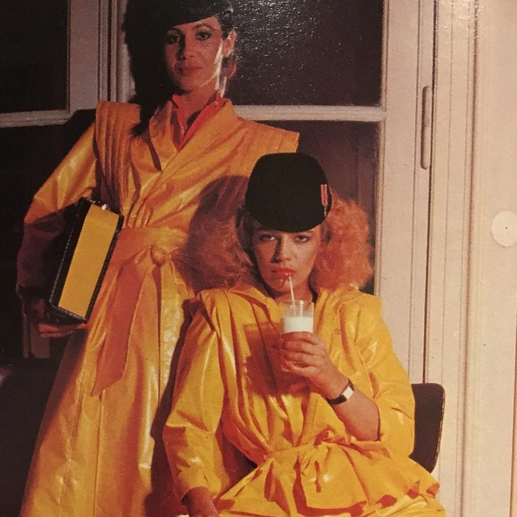 Sipping milk in yellow raincoats and brimless fedoras This washellip
